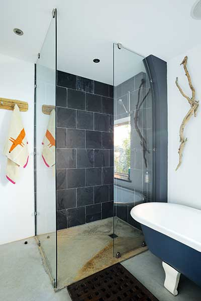walk in shower with slate tiles