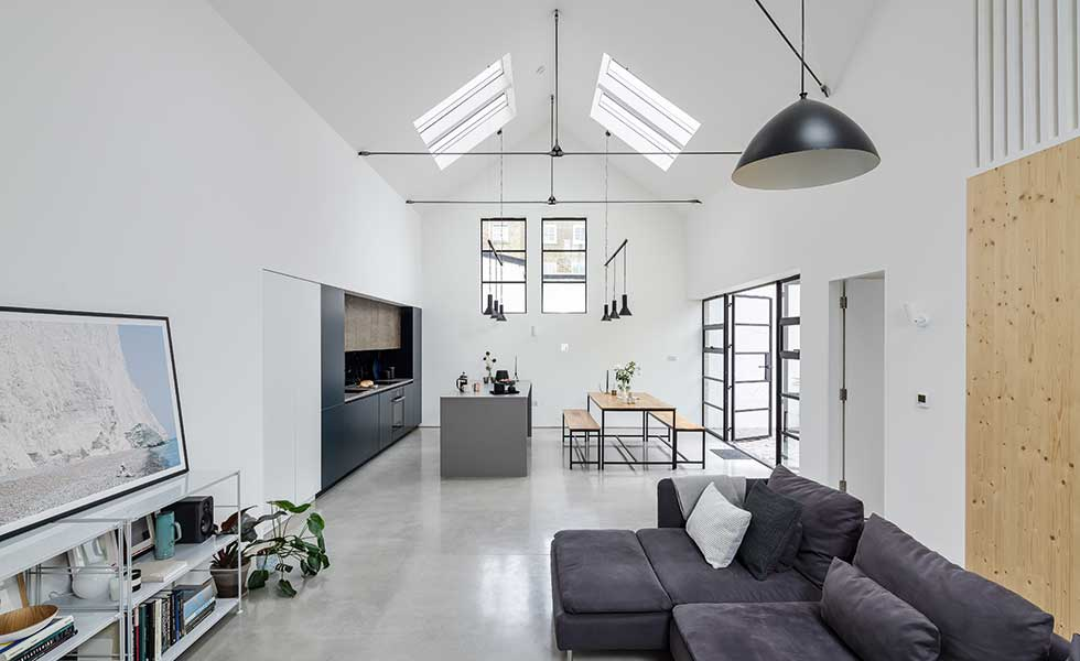 ... As The Concrete Floors, Fresh White Walls And Low Hanging Pendant  Lights Create A Harmonious Atmosphere Throughout The Kitchen, Dining And  Living Area.