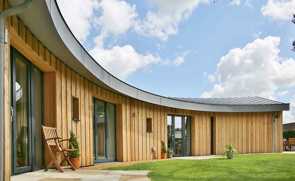 A curved timber-clad Passivhaus