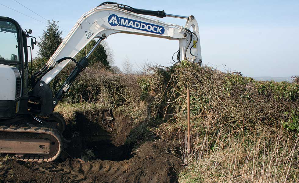 Digger clearing building plot
