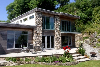 Lakeland Timber frame case study eco house garden view