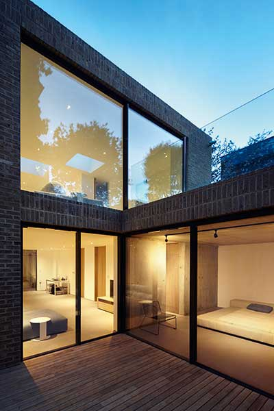 basement level of London brick self build with courtyard garden