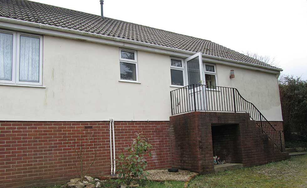 chalet bungalow on a sloping site before remodel