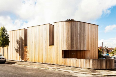 cedar clad inner city self build on a corner plot