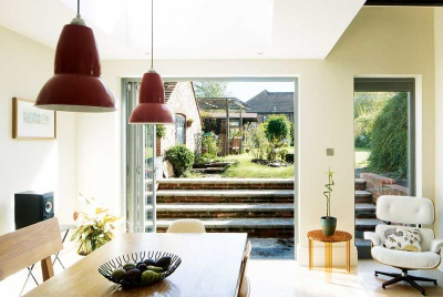 view of the garden through open bi fold doors of renovated home