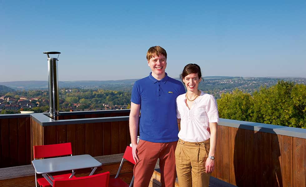 Tom and Emily Hunt on the roof top terrace of their self build on a city plot