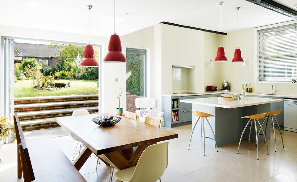 kitchen diner with eclectic modern fittings and bi folds to garden
