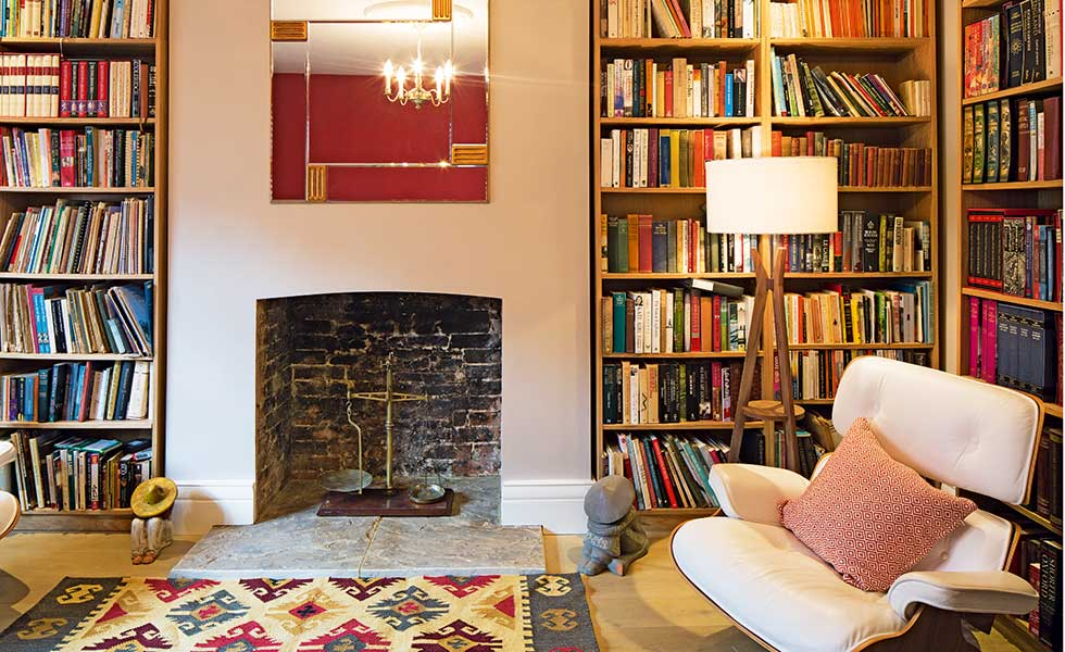 living room with full bookshelves in renovated home