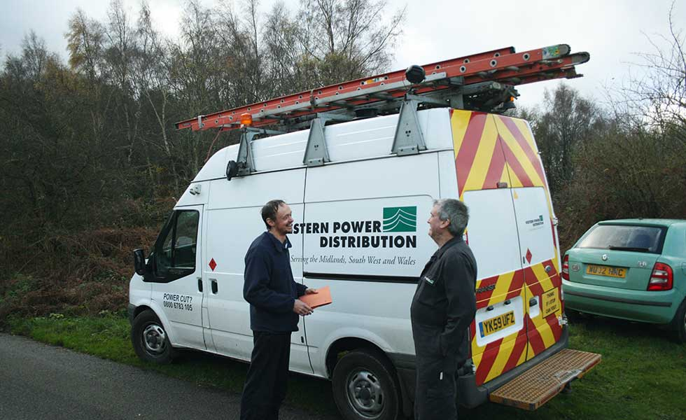 western power van checking services on a building plot