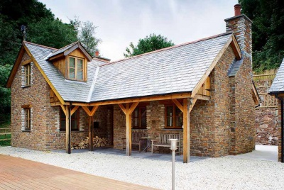 an eco-friendly cottage built from stone showing how small homes can be practical and beautiful