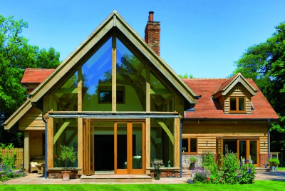 The complete oak home blue sky glass front