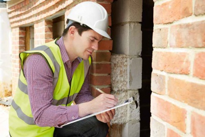 A building inspector carries out a statutory inspection