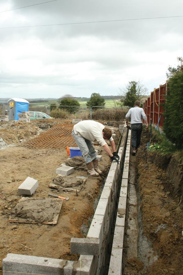 Building up the foundations to damp proof course