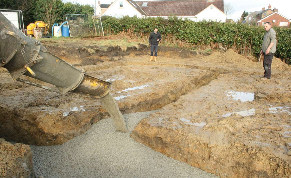 Pouring the concrete to create the foundations