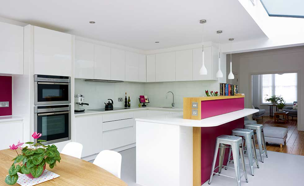 Kitchen Diner With Pink Features And Breakfast Bar