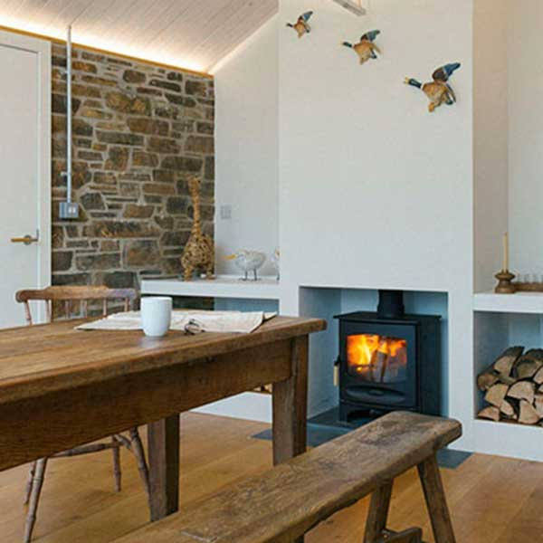 cottage dining room with oak table and log burner
