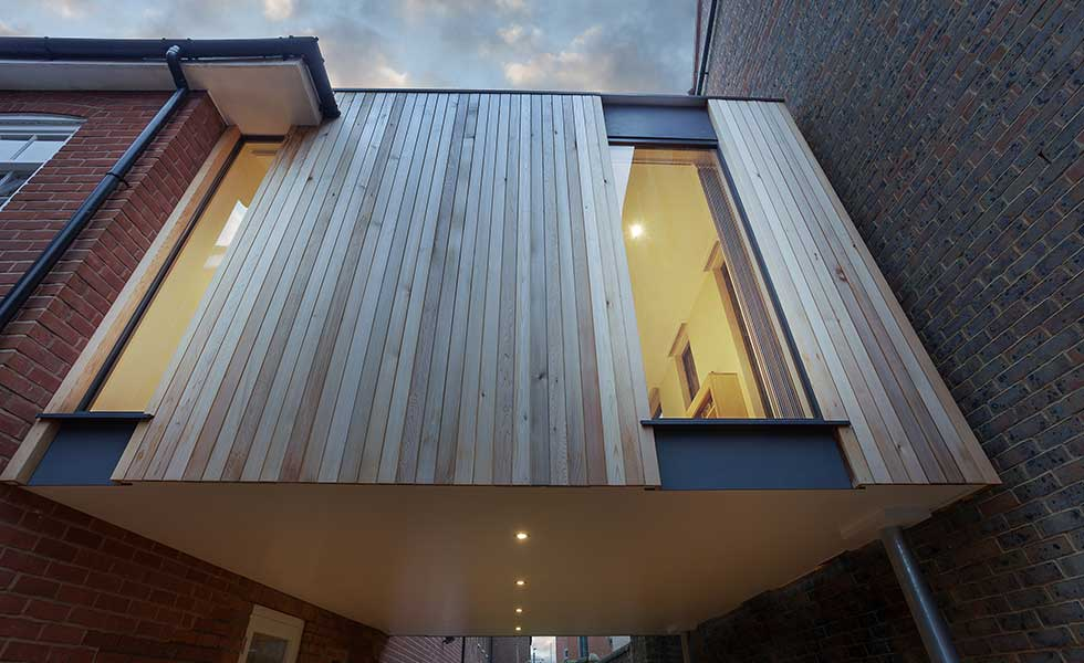 glass and wooden panelled modern extension
