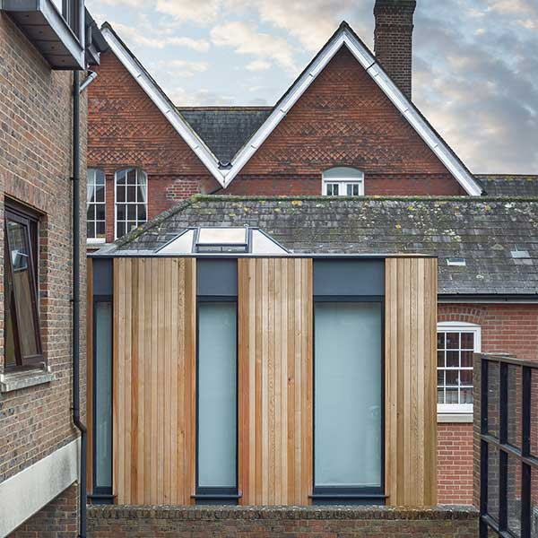 modern wooden panelled and glass extension