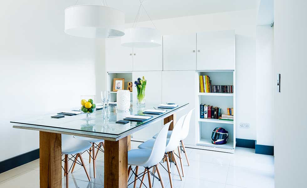 white modern kitchen with glass and wood table