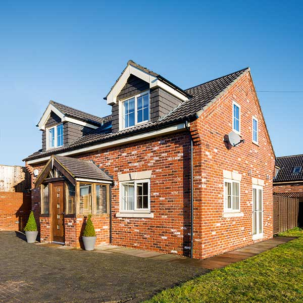 12 homes built for under a 150k budget homebuilding for Brick home construction costs