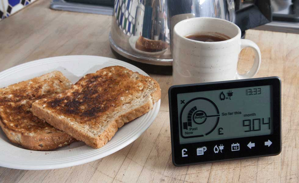 smart meters can work with control pads like this one seen on a table with kettle, cup of tea and toast