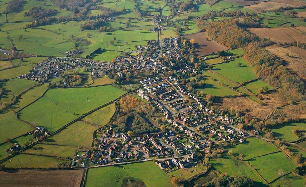 aerial view of a village with houses and potential building plot land