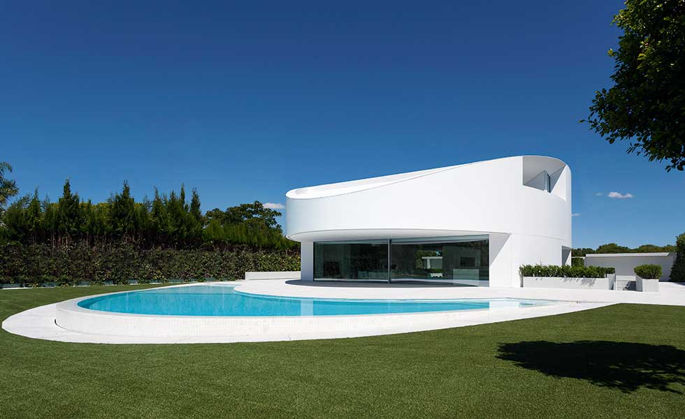 circular white house with pool and large glass window in Valencia Spain