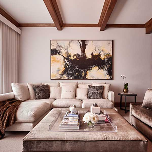 beige and brown living space with velvet sofas