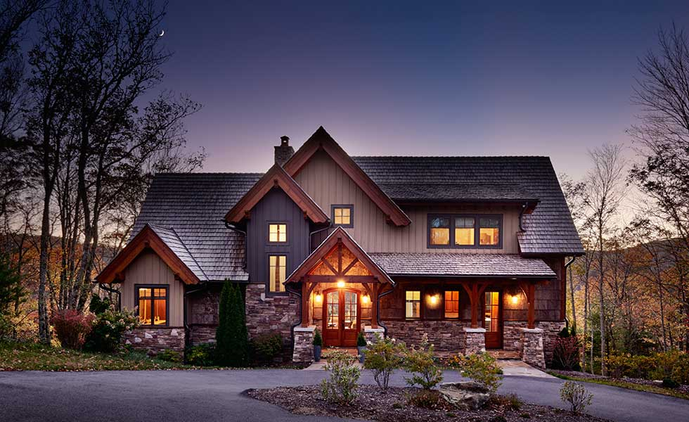 evening shot of classic american home with wooden and stone features