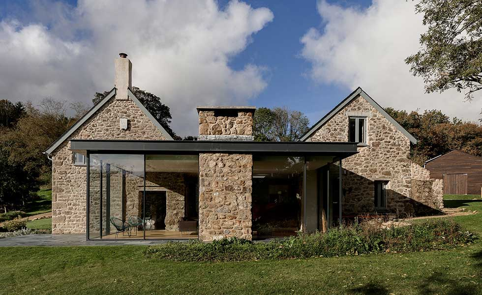 glass extension attached to original seventeenth century farmhouse