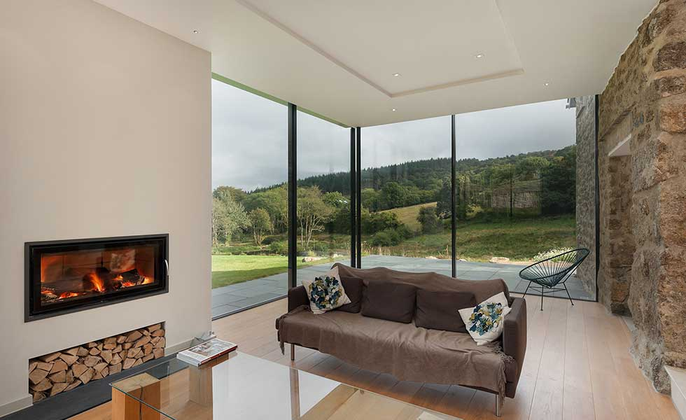 overlooking countryside from glass extension living space