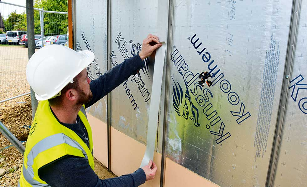 man finishing external insulation of a Potton passivhaus