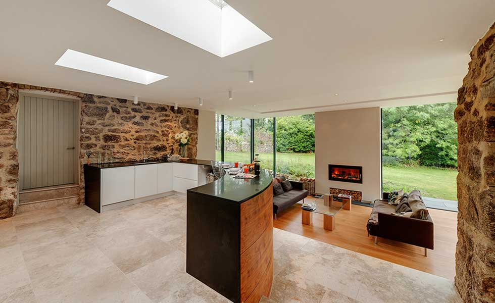 open plan living and dining space with exposed wall