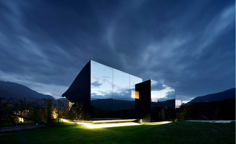 dark glass mirrored home in Bolzano, Italy