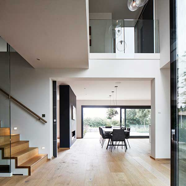 open plan living space with large landing, glass panelling on landing and dining space