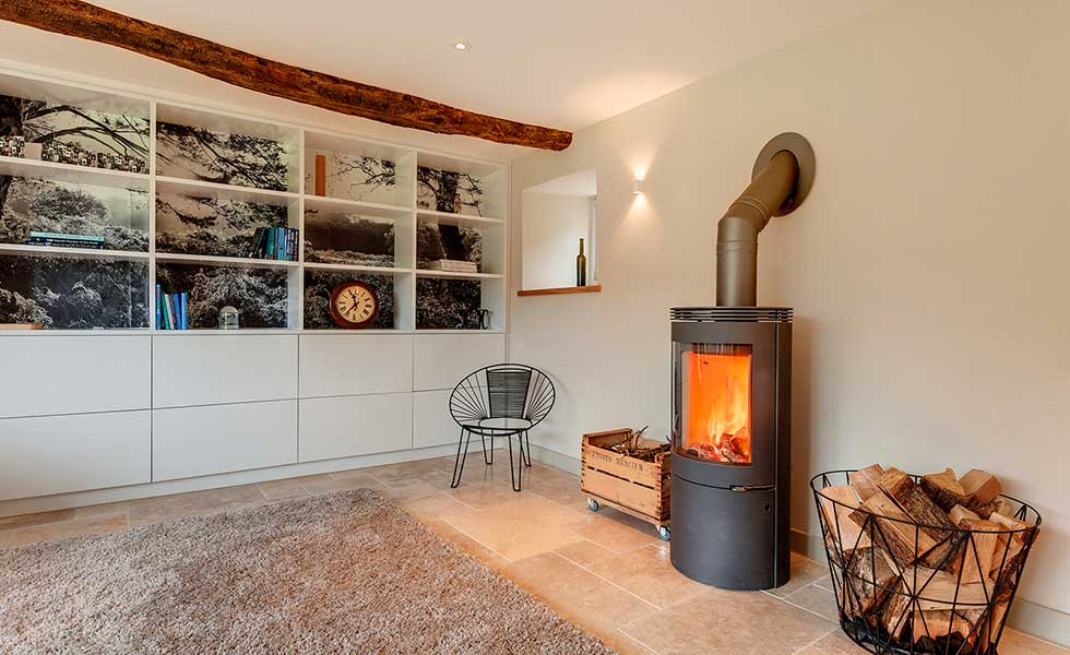 room with log burner and storage