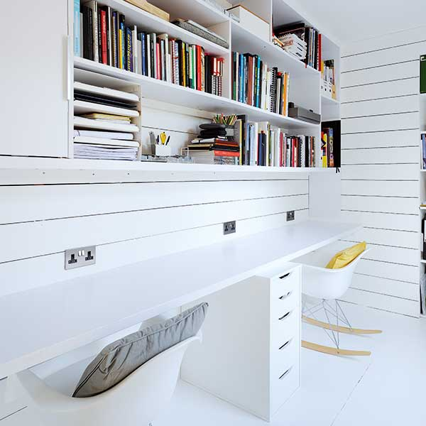 scandi style office space with rocking chairs, white desks and bookshelves