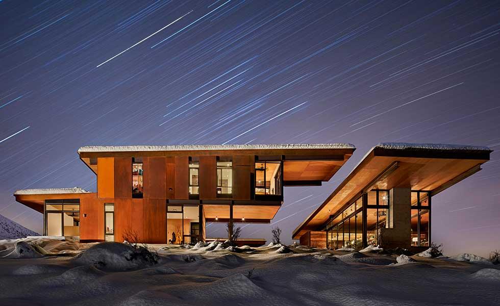 wooden Washington home in snow