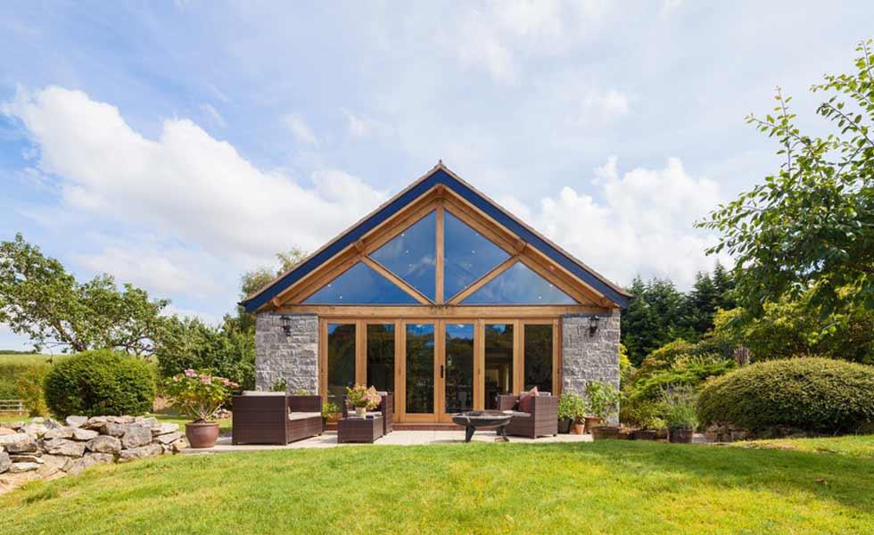 harkin welsh oak frame timber house beams lawn