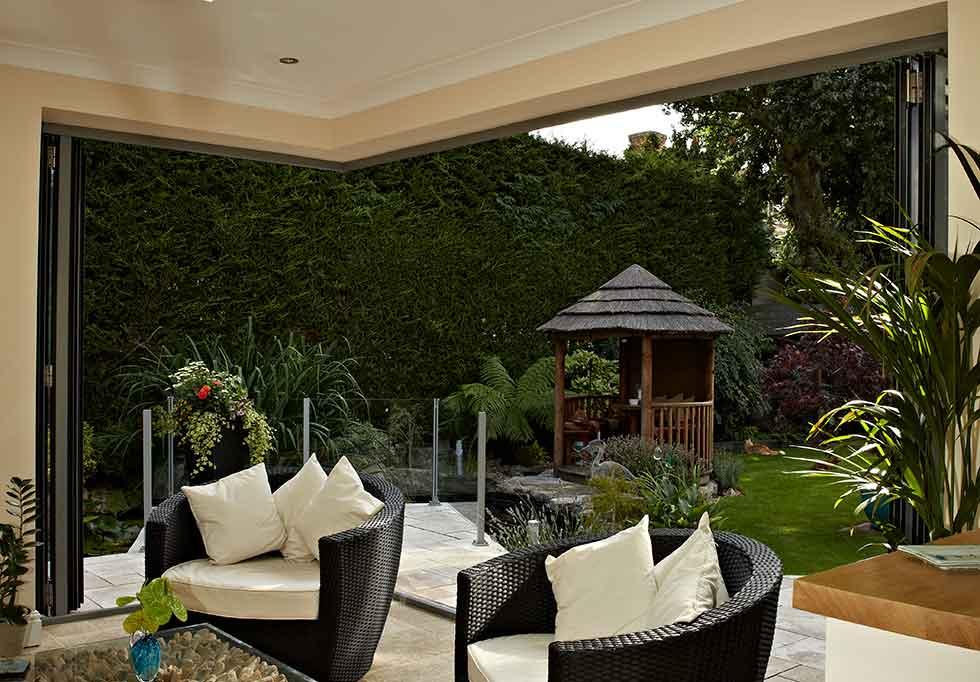 origin open plan living garden rattan chairs cream cushions