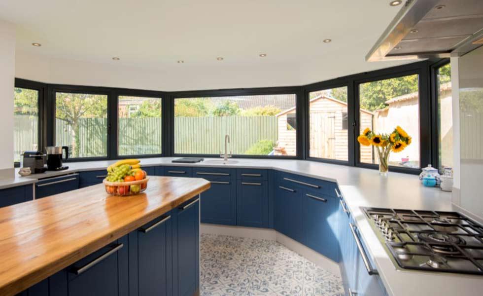 origin blue kitchen cupboards oranges