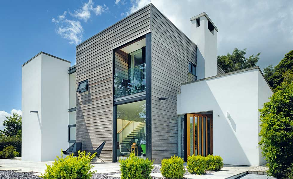 Render and timber clad exterior of Devon self-build