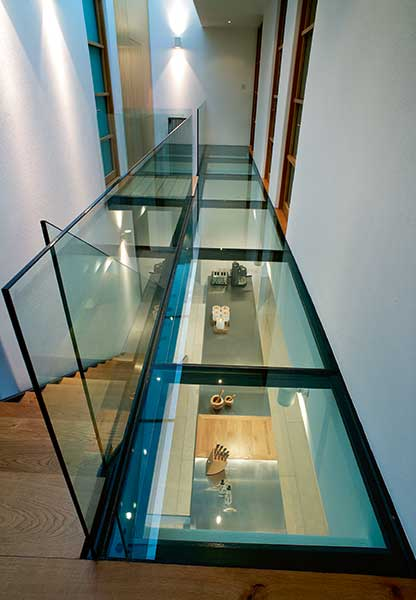 glass floor walkway and ceiling in modern self build