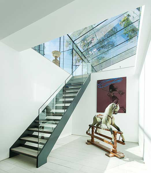 open tread staircase in extended and renovated home