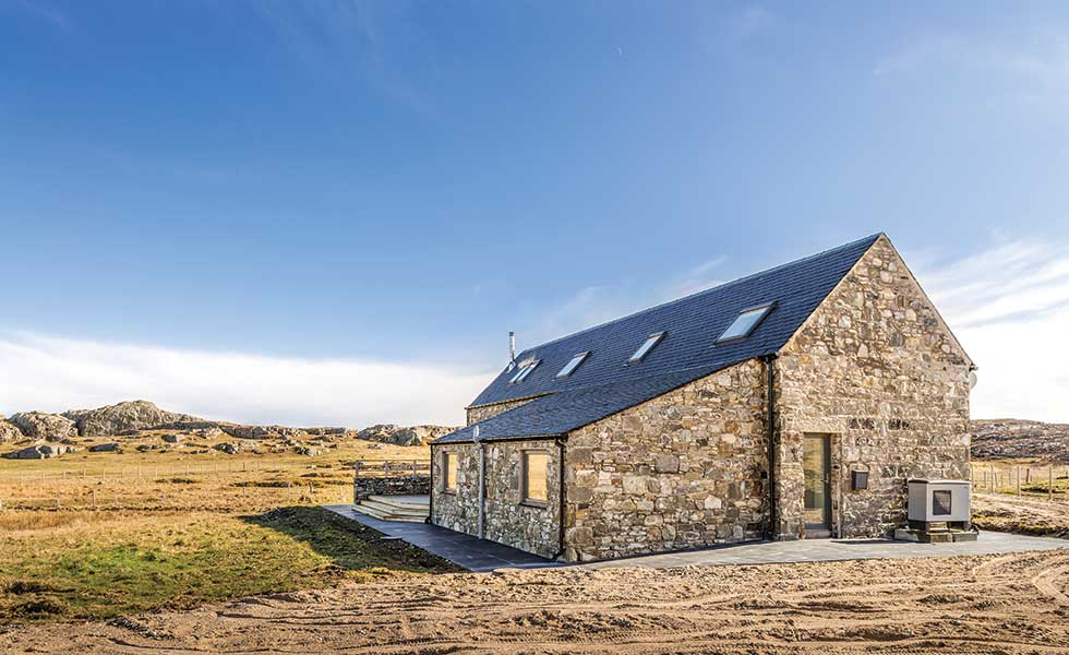 air-source heat pump on a stone cottage renovation