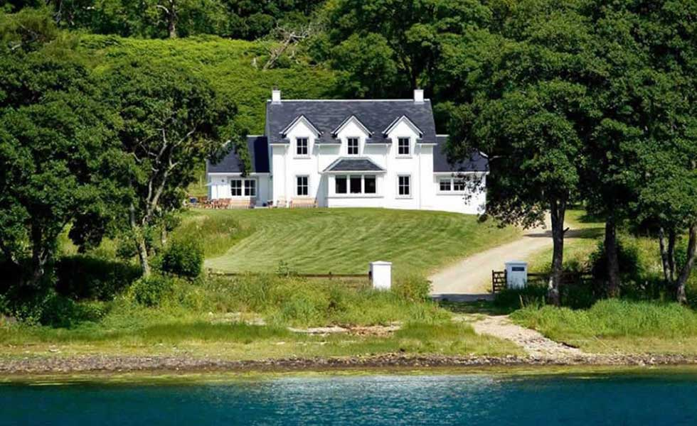 traditional highland loch side home