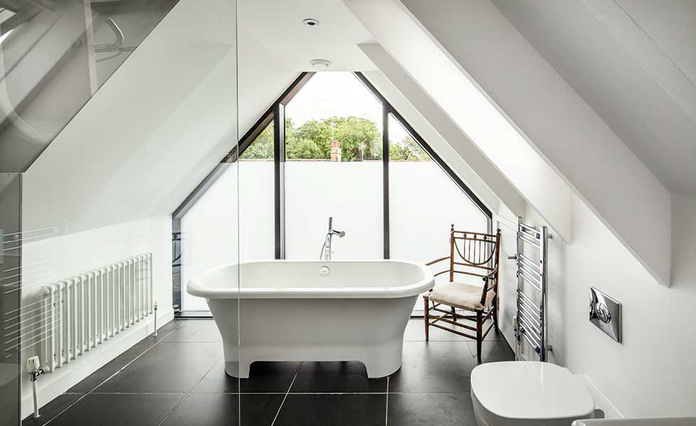 glazed gable end of a bathroom with a vaulted ceiling