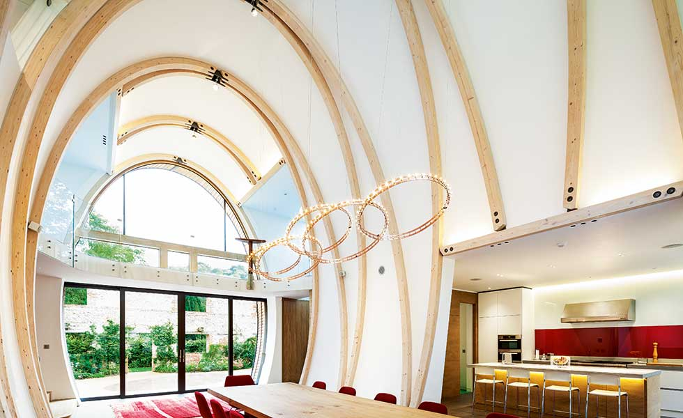 curved ceiling glulam self build dining area