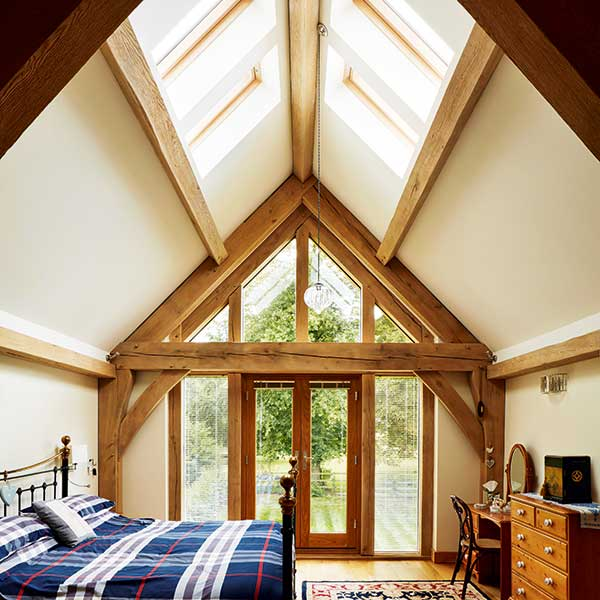 15 design ideas for vaulted ceilings homebuilding for Master bedroom lighting ideas vaulted ceiling