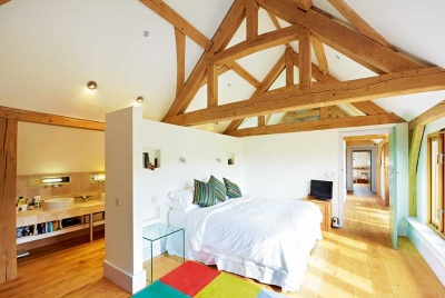 vaulted ceilings of an open plan bedroom and en suite